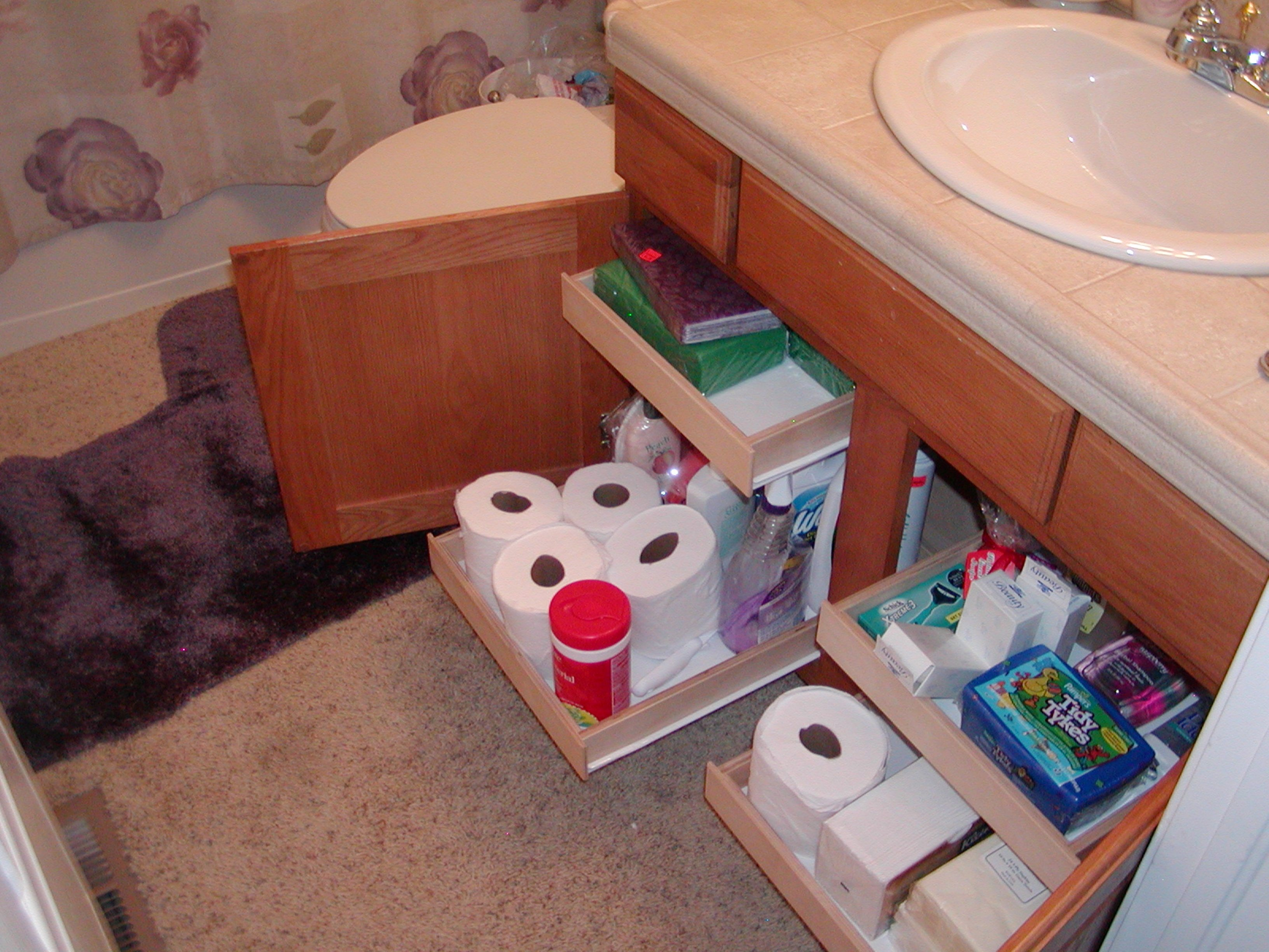 increased bathroom storage with pull out shelving